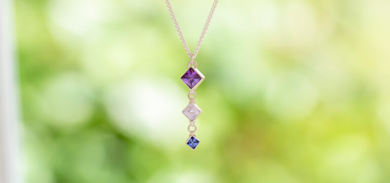 Small square faceted stone pendant on a chain