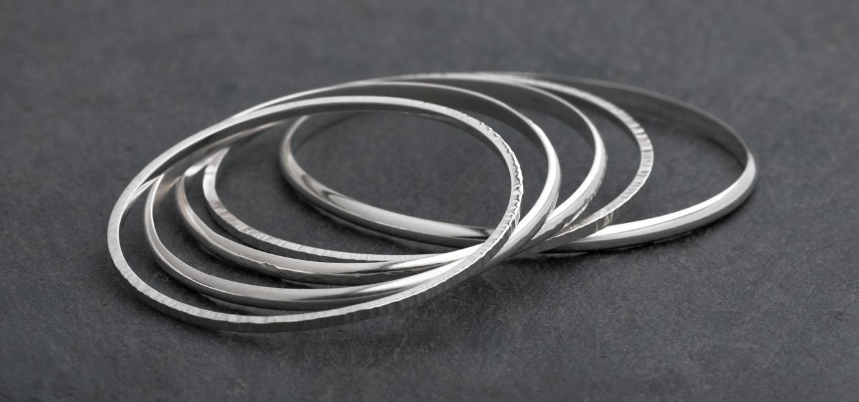Silver hammer textured bangles