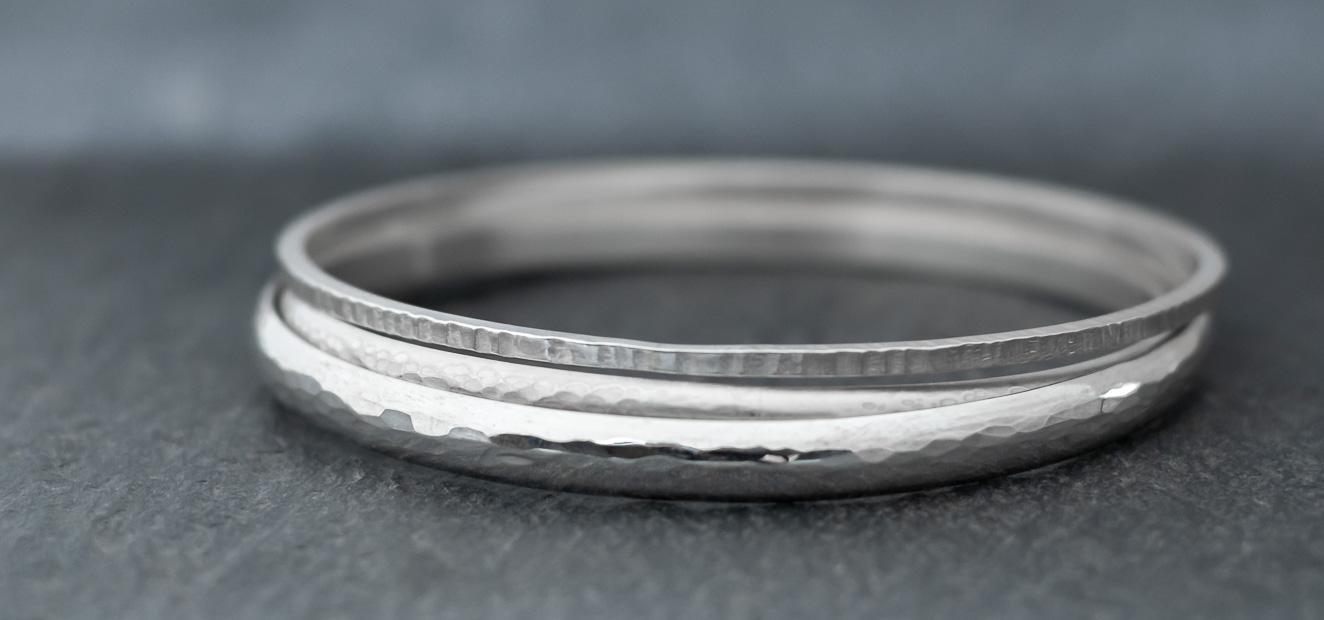 Silver hammer textured bangles