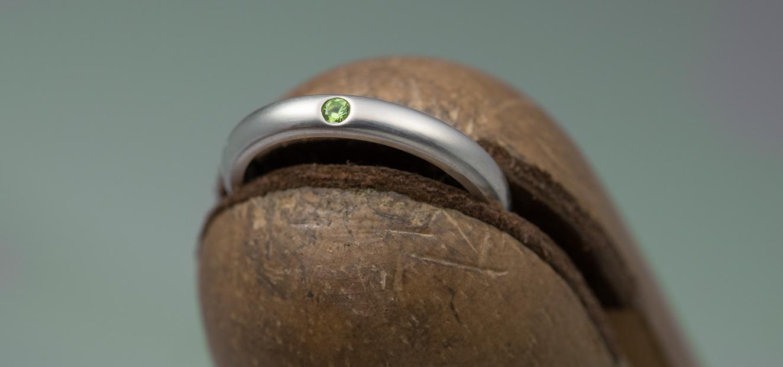 silver ring with flush set peridot stone
