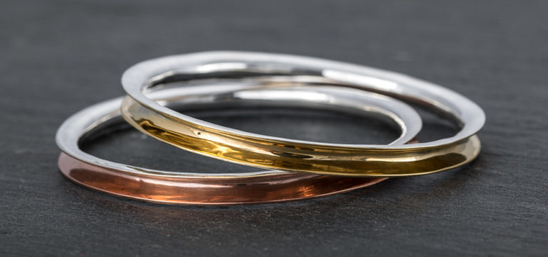 anticlastic silver bangles made on the anticlastic raising workshop