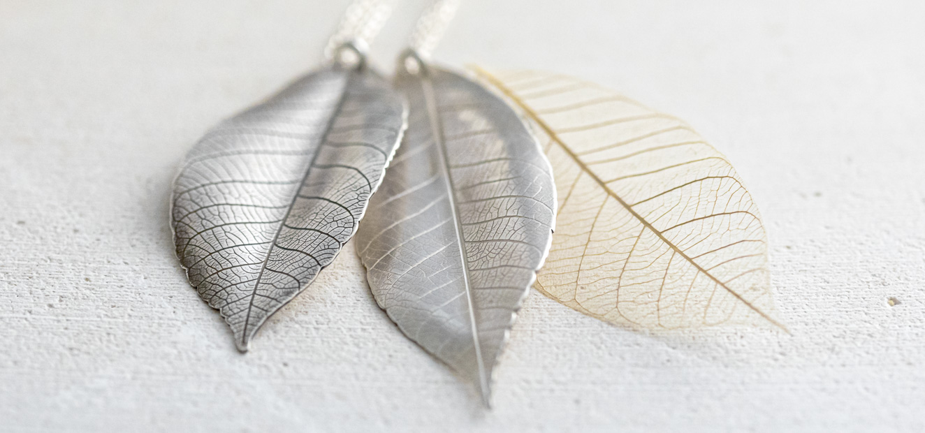 oxidised and plain silver leaf pendants with a skeleton leaf