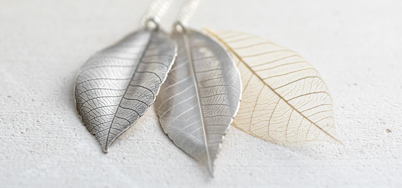 oxidised and plain silver leaf pendants with a skeleton leaf