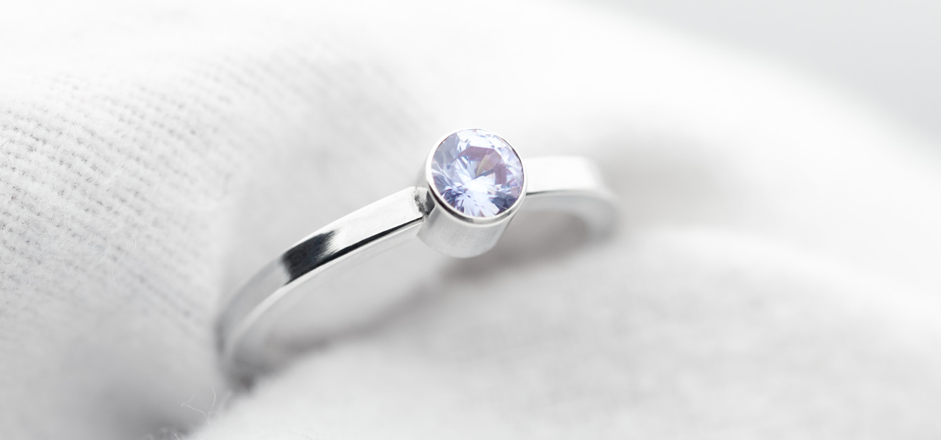 Faceted stone setting on a silver ring